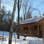The exterior of one of our quaint cabins in winter.