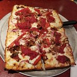 8-slice detroit style pizza with sausage, pepperoni & onion.