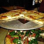 the quattro formaggio pizza and the works pizza