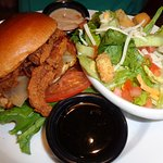 Whiskey glazed chicken sandwich with salad