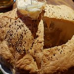 Slow-cooked beef in a treacle, root vegetable & ale sauce, topped with puff pastry, served with