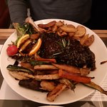 Goose with wedges and vegetables