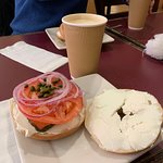 Empire State of Mind breakfast sandwich on a gluten-free bagel. The drink is a chai latte.