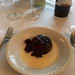 Handmade Aged Christmas Puds served with Brandy sauce & Sour Berries.