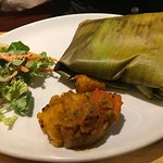 fish curry wrapped in banana leaf