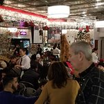 A view of the busy dining room, at Cannoli King (Caffe Palermo) in Little Italy, NYC.