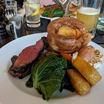 Sunday Roast Rump of Beef, roast potatoes, carrots, cabbage, yorkshire pudding, and roast garlic