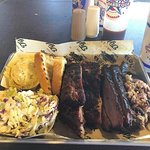 3 Meat Combo with ribs, brisket, pulled pork, texas toast, potato salad and coleslaw.