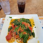 Tilapia with spinach over rice.