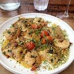 Ravioli with prawns, pistachios, and pumpkin sauce.