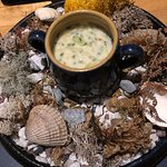 Seafood chowder served on a bed of seaweed and shells