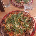 spicy salame, roman artichokes and black olive pizza.