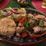 Seabass prepared fajitas style with peppers and onions.