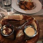 Buttered giant pretzel with bacon sour cream and buffalo wings. Excellent.