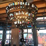 Upstairs beer bottle chandelier