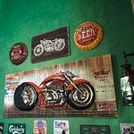 На стенах различные мотоциклы и машины