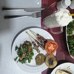 Lamb skewers with cooked tomato, onion, and arugula salad. Never forget to ask bubbly homemade A