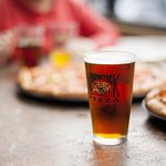 Enjoy pizza and a beer.