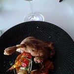 Roast duck leg and vegetables