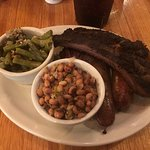 2 meat combo (2nd cut brisket and sausage) with a side of a beef rib, green beans and jalapeno b