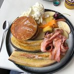 Hot Cakes - with fried banana, bacon, maple syrup, fresh fruit and whipped cream - absolutely yu