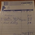 Our bill showing the prices of our meals that night.
