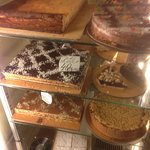 Selection of cakes including cheesecake, crumble, custard feuille, lemon meringue