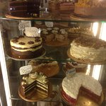 Selection of cakes including chocolate, chocolate and mint, chocolate and orange, and pomegranat