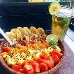 Tropical granola bowl and iced green tea.