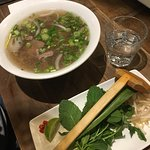 Steak 'pho' broth with DIY herbs, bean shoots and chillies