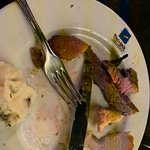 The remnants of our plate after gluttony with steak, lamb chop, brazilian sausage