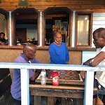 Locals having a drink at Potters Cay