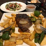 Steak and chips with vegetables