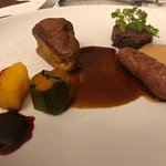Roe deer and roe deer sausage with pumpkin pudding, celery puree and raspberry sauce