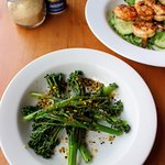 Stir fried broccolini topped with housemade hazlenut dukkah
