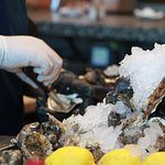 So many oyster shuck - this place never stops!