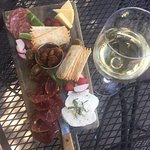 Charcuterie board with a glass of Sauvignon Blanc. Delicious.