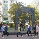 people passing in front of the monument