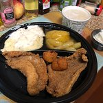 U.S. Farm-Raised Catfish with Mashed Potatoes and Saw Mill Gravy, Fried Apples, Dumplins and a free sample of Cole Slaw.