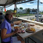 On the upper level looking over fried clams nd a lobster roll. Great view of ocean and marsh