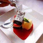dessert. chocolate cake with cream and raspberries