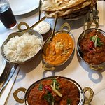 Naan bread, rice, chicken and lamd dishes.