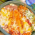 Combination plate with tamale, enchilada, and taco