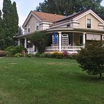 This is a wide shot of A Stone's Throw Bed & Breakfast in Interlaken, NY.  A beautifully maintained house on about 1 acre of beautifully lawn and gardens!