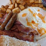 Fairway Breakfast: 3 Eggs over easy. 2 sausage links, 2 slices of bacon and generous portion of
