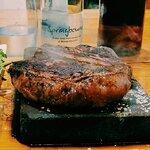 Sizzling steak on hot stone ...