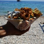 Huge seashell with fried squid