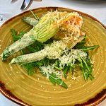 crispy zucchini flowers stuffed with a mix of ricotta & mint, topped with Parmesan & a lemon& ho