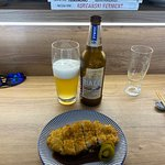 Fried & breaded pork chop with a bottle of Biale Wheat Beer.