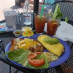 Crab Omelette with cheesy hashbrowns and Bloody Mary's in an outdoor setting